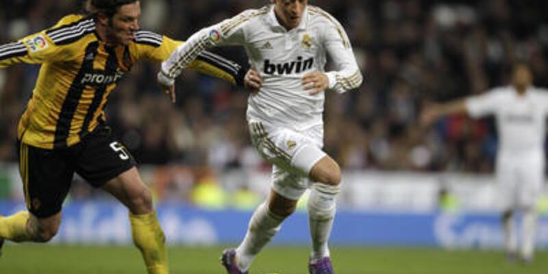 Mesut futbolu Real Madrid'de bırakacak