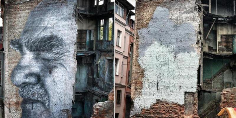 Grafiti sanatçısı JR'ın eserini boyayarak kapattılar