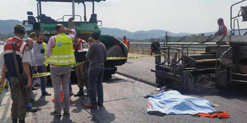 20 tonluk asfalt kamyonunun altında kalan işçi feci şekilde can verdi