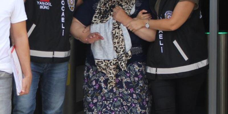Hırsızlık şüphelisi kadın, adliyeye götürülürken göbek attı