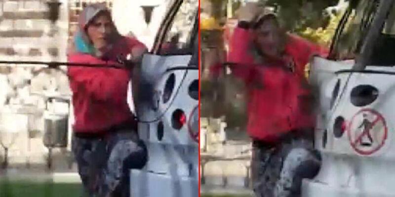 Tramvayın arkasına asılan kadının tehlikeli yolculuğu