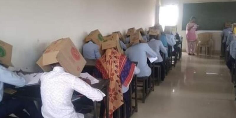 Hindistan'da tepki çeken uygulama: Kopya çekmesinler diye öğrencilerin başına koli geçirildi!