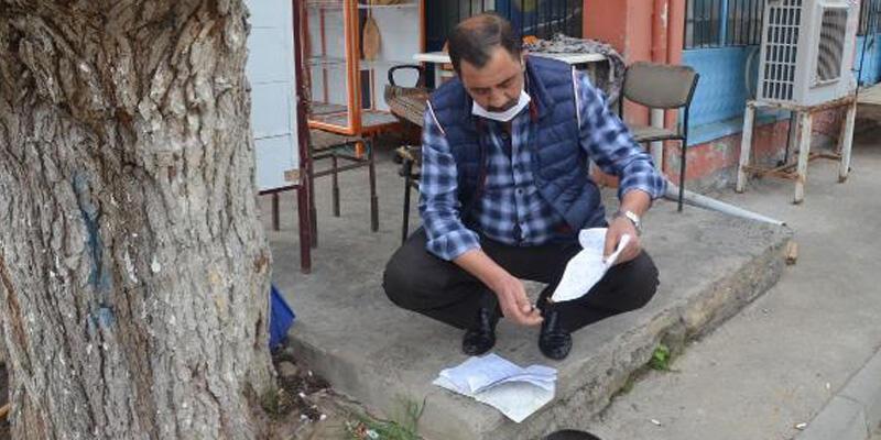 18 ailenin 22 bin TL veresiyesini kapattı, defteri yaktırdı