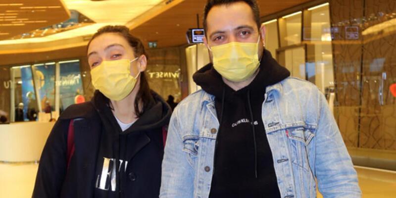 Merve Dizdar ve eşi Gürhan Altundaşar el ele alışverişte